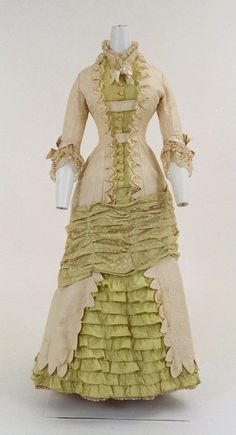 Bunka Gakuen Costume Museum  c.1880 | I adore how the sash goes inside and the dags hang over the centre back.
