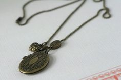 Antiqued Gold Scent Locket Necklace with charms by BallyhooBath, $10.80