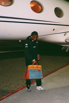 Travis Scott wearing Supreme North Face Steep Tech Hooded Sweatshirt, Nike Flyknit Racer, Vetements Cut-Off Sweatpants