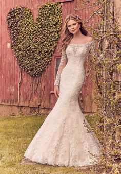 Karlee - 23818 just arrived in a stunning size 22! Show of your sexy curves ladies! Try this stunner on at Aurora Bridal in Melbourne, FL 321-254-3880