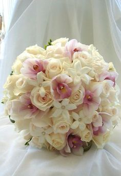 White roses and pink orchids bouquet