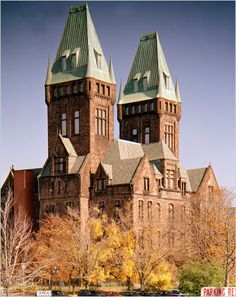 Buffalo, NY  Henry Hobson Richardson built his largest commission in 1870, the Buffalo State Asylum for the Insane, which is composed of a pair of soaring Romanesque towers flanked by low brick pavilions.