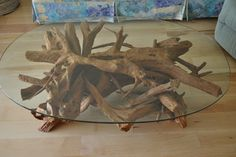 "Florida red cedar driftwood & glass coffee table -  Once additional smaller pieces are added for total stability, the table is perfectly leveled & then sandblasted. Instead of then lacquering or sun bleaching, the table is left in the raw look to display the reddish/brown/blond tones found naturally in red cedar. All cut ends have a very aged look. Bottoms are epoxy resin sealed to protect floors. The 30 x 48 oval glass is 1/2"" with a pencil polish edge. Height = 17""…"
