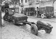 A 75mm pack howitzer of 'F' Troop,1st Airlanding Light Regiment RA in an Italian village. November 1943.