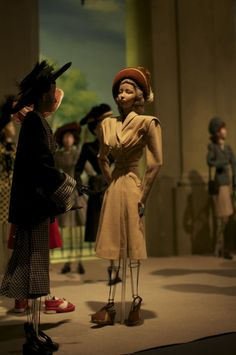 [dolls dressed in black and white ensemble by Jean Desses and a tan wool day dress by Agnes Drecoll, from the Théâtre de la Mode - this was first displayed in March 1945 at the Museum of Decorative Arts in Paris, and dolls are on display at the Maryhill Museum of Art; via the FIDM blog]
