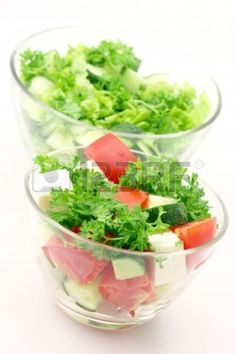 5176642-two-glass-bowls-with-various-salads-close-up-on-white-background.jpg 798×1.200 piksel