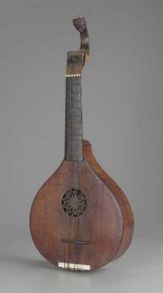 1770 English Cittern at the Museum of Fine Arts, Boston - Citterns were instruments dating back to the Renaissance.  However, in England, they continued to be used for casual music-making well into the 18th century; for instance, one might be kept in the waiting room at a barber shop so clients could amuse themselves as they waited.  In that way, they were similar to acoustic guitars today, where many people could play one just for fun.