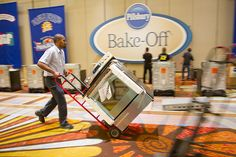 General Electric technician Steven Fonseca places one of the 100 ranges on the contest floor in preparation for the 45th Pillsbury Bake-Off® Contest!