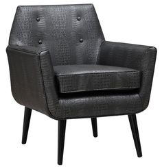 Clyde Croc Leather ChairThe croc bonded leather chair offers a moden spin on our popular Clyde chair. This chair offers a clean Mid-Century aesthetic while the small scale button tufting adds a pop of personality. Perched on solid wood legs, this chair is a true classic and is a fashionable addition to living rooms, bedrooms and entryways.Dimensions26.8