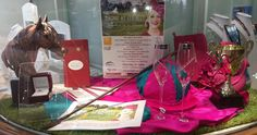 Display for Rockhampton Cup Fashions on the Field with an aquamarine and diamond ring to be won.