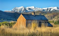 Mt. Timpanogos stands in majesty behind the old Tate Barn near Soldier Hollow outside of Midway, Utah. (c) 2011 Tom Kelly