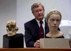 """Doug Owsley, division head for Physical Anthropology at the Smithsonian's National Museum of Natural History, displays the skull and facial reconstruction of """"Jane of Jamestown"""" during a news conference. They have found the first solid archaeological evidence that some of the earliest American colonists at Jamestown, Va., survived harsh conditions by turning to cannibalism presenting the discovery of the bones of a 14-year-old girl, """"Jane"""" that show clear signs that she was cannibalized..."""