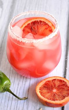 Throwing a dinner party? Try this Blood Orange Margarita, a yummy twist on a classic cocktail that your guests will adore! @thehitfiles