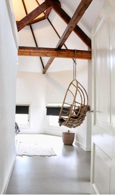 Love the swing chair and the wooden accents!