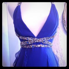 Royal Blue Silk Sequin Mandalay Flutter Dress GORGEOUS Mandalay deep royal blue silk chiffon ruffle flutter fairy dress with beautiful rhinestone/crystal/sequin criss cross waistband and back cross straps. The dress is superbly constructed and has built-in bra cups. Size 2 HOST PICK!! Mandalay Dresses