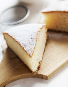 slice of yogurt cake with tea on background served on the wooden table