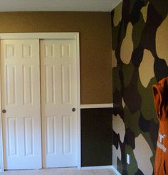My sons army room with camo accent wall