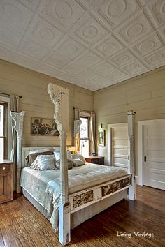 our bed made with porch posts, old doors and reclaimed tin, plus our tin ceiling - Living Vintage