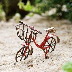Antique Mini Bicycle - Red. Fairies absolutely love to ride around on this antique bike. The basket is perfect for them to collect odd along the way. #fairygardeningaustralia