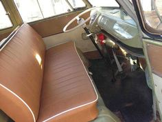 mango split screen van with brown bench seat