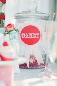 Vintage carnival themed decor for candy jars.