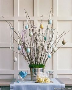 So pretty for our Easter centerpiece. I can't wait to make this! We are going to pick up the fallen twigs from our neighborhood nature trails, and spray paint them white.