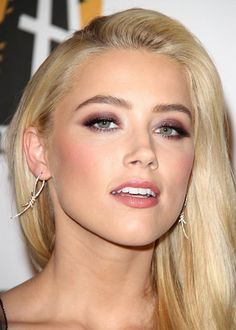At the 15th Annual Hollywood Film Awards Gala in Beverly Hills, the look was all about a sultry brown smoky eye with rosy lips and peachy cheeks.