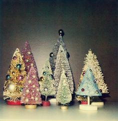 vintage christmas trees. DIY with metallic spray pant, glitter and mini ornaments or beads.