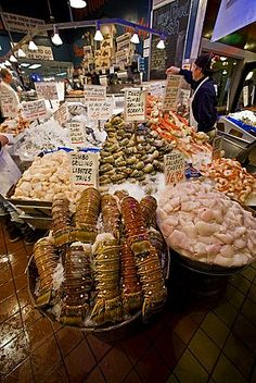 Views of the famous Pike Street Market in downtown Seattle, Washington State, USA. Pacific Ocean. This market is a huge destination for both residents and tourists to the Seattle area, selling fresh seafood and produce, as well as many other items of inte