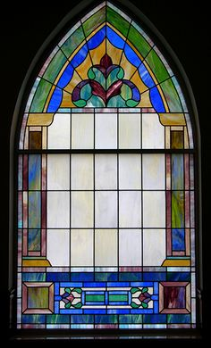 Stained glass window with opaque panes.
