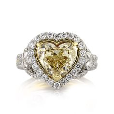 This beautiful fancy yellow heart shaped diamond ring is remarkable from every angle! The heart shaped diamond is elegantly showcased in the center of this piece and it GIA certified. Heart Shaped Diamond Ring, Heart Shaped Engagement Rings, Yellow Diamond Rings, My Engagement Ring, Designer Engagement Rings, Heart Jewelry, Anniversary Rings, Beautiful Rings, Colored Diamonds