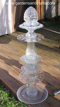 glass tower made from recycled glass pieces. definitely on my summer 'to do' list. - Another reason to hit all the little junk, thrift, and consignment stores in my hood!
