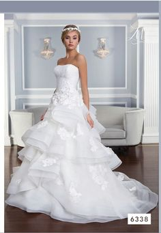 Lilian West.. 2015 look book this is a contender for the wedding just need it in Ivory