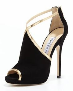 JIMMY CHOO, black peep toe pump with golden lining and strap.
