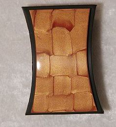 Mica Shift Basketweave tutorial  by Tonja Lenderman  As seen in the April 2004 issue of Jewelry Crafst Magzine (gold and black clay)
