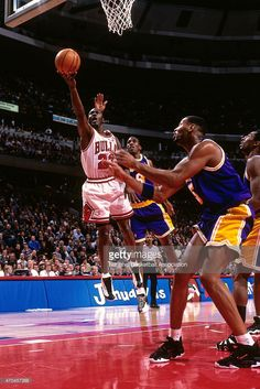 Michael Jordan #23 of the Chicago Bulls shoots against the Los Angeles Lakers on December 17, 1997 at the United Center in Chicago, Illinois.