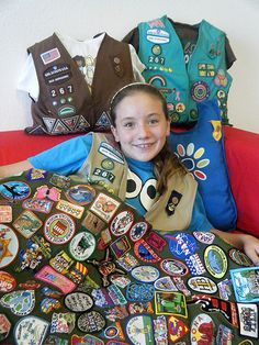This is so awesome! A family makes blankets with their Girl Scout fun patches as keepsakes.