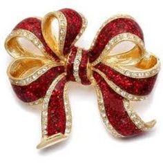 Brooch in yellow and white gold with rubies and diamonds.