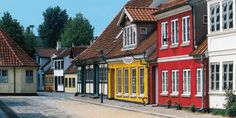 The cobblestone streets in Funen, Denmark are lined with colorful houses.