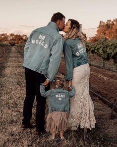 Denim jackets with Mr & Mrs Gould, daughter wearing smaller denim jacket saying 'Mini G' {Mickala Thomas}