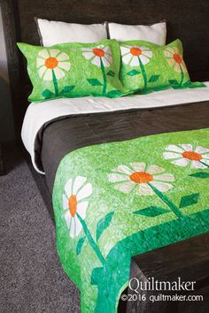 Coming Up Daisies quilt pattern: Freshen up your bedroom for springtime with this cheerful bed runner and pillow sham set designed by Eileen Fowler.