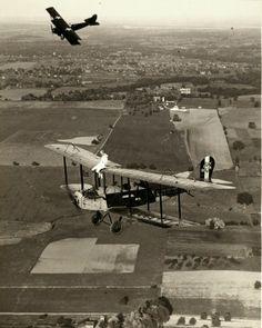 July 4, 1924 - Bertie Brooks performing on top of a Marie Meyers Flying Circus bi-plane.