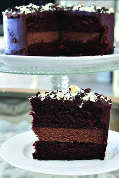 This Chocolate Cheesecake Cake recipe is a decadent Chocolate Cake with a layer chocolate cheesecake in the middle. A how to video is included. Cheesecake Cake, Cheesecake Recipes, Dessert Recipes, Chocolate Cheesecake Cupcakes, Yummy Recipes, Food Cakes, Cupcake Cakes, Decadent Chocolate Cake, Chocolate Desert Recipes
