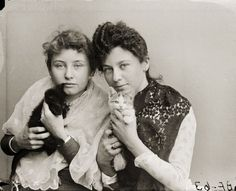 Hattie (Harriet) and Nellie Bennett posing with pet kittens. - Historical Image | Wisconsin Historical Society