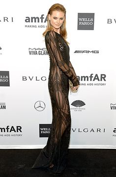 Behati Prinsloo The Victoria's Secret model wore an Emilio Pucci black gown with sheer side paneling to the 2014 amfAR New York gala.