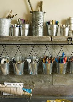 Storage Solutions CRAFT SUPPLY STORAGE Organizing is easy when you have a place for everything. Galvanized tins in various sizes coral pencils, brushes, and other craft supplies. Hang containers above your work surface for easy access