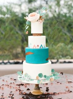 Modern Southwestern wedding cake with vivid turquoise tier and metallic accents/  - Melissa Jill Photography