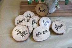 Wood slice table numbers for your wedding. With by thatcraftybrit