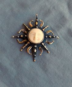 I have a pendant/pin like this I wear on a long silver chain with a long double strand of small baroque pink and cream pearls.I get lots of compliments.  I also wear mine on my suit lapel.  When I bought mine year ago, it was advertised as prehistoric walrus ivory.