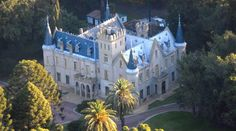 Estancia La Candelaria is a spectacular castle in Lobos, featuring luxurious suites with antique furniture and marble bathrooms. Gaucho, Third World Countries, Great Hotel, Top Destinations, Barcelona Cathedral, Places To Visit, House Styles, City, Building